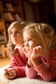 girls watch tv i stock