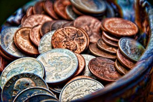 quarters, pennies, dimes and nickels in a jar