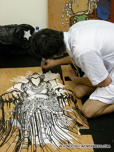 Ang moh artist, dressed up like The Joker while painting