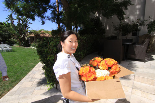 me carrying the bridesmaids bouquets