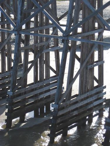 The trestles of an old railway bridge.