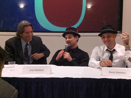 Prendergast with Joel and Benji Madden (Good Charlotte band members, matching hat enthusiasts).