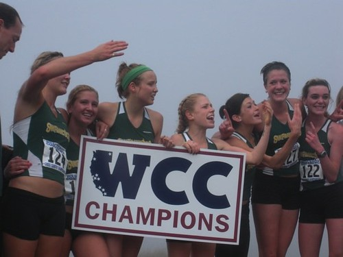 The Women's Cross Country team celebrates their first ever WCC championship.  Photo Courtesy of Alice Baker