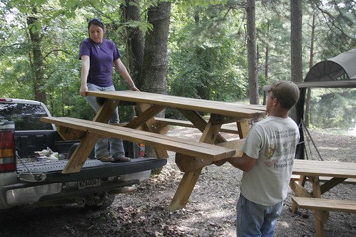 Leigh-Anne and; Kyle moving picnic tables to another area of the park.