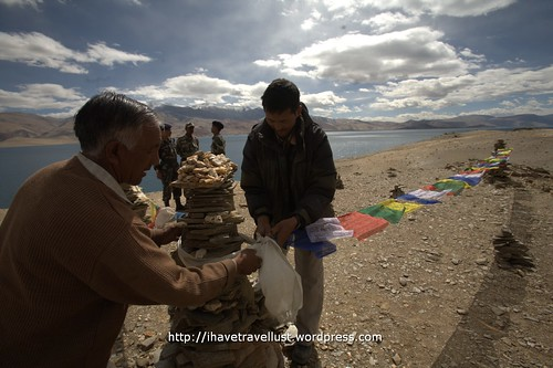 Setting prayer flags at Tsomoriri Lake