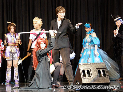 A cosplay group participating in the cosplay competition on stage