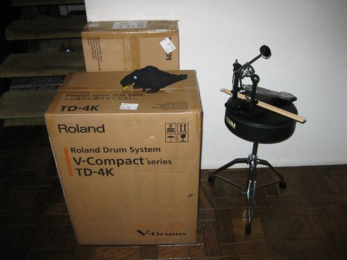 Roland TD-4S as delivered, plus Tama drum throne, Pearl kick pedal, and Sharkie, who is hiding from the kitten.