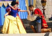 Snow white gets a kiss on the hand from a prince
