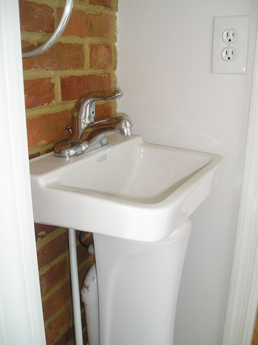 Poorly installed small sink