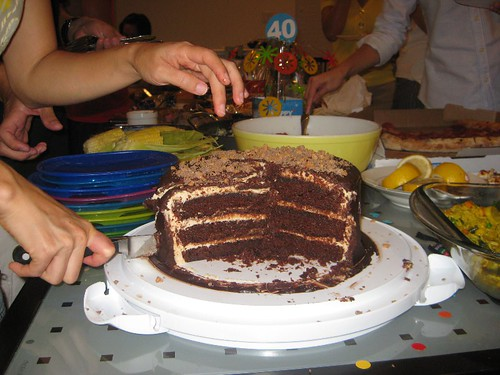 Three layers of moist chocolate cake, coated with the PB Cream Cheese, covered with ganache :)