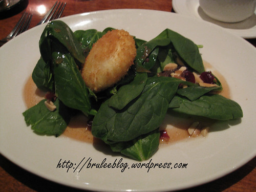 Medallion of warm chevre with spinach, almonds, bacon and cranberry port dressing