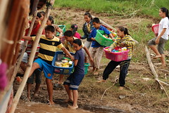 Kids storm our boat at a shoreside stop to sell food and beverages
