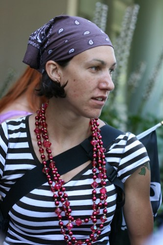Striped shirt, bandana and beads