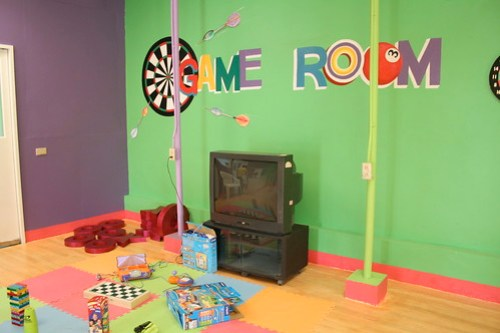 Inside the Game Room of Sweet Harmony Gardens