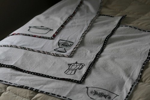 Four embellished tea towels