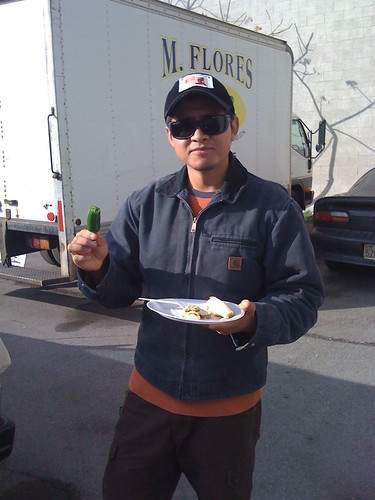 Ruben enjoying a hot pepper along with his tamales.