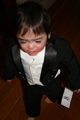J. being miserable in his tux.