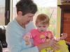 Claire, her Dora stickers, and Grandma Judy