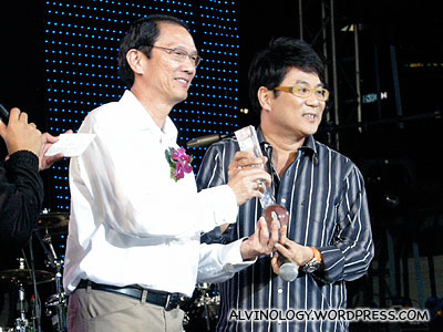 Movie director, Jack Neo receiving his award