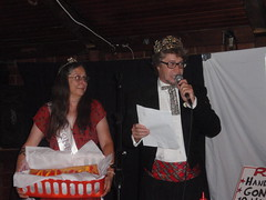 As the hot dog queen looks on, Bob Satmary reads the rules of the days contest.
