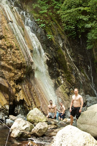 The beautiful white hot spring waterfall is pretty unique.  The hairy foreigners arent.