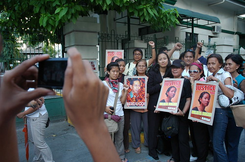 Melissa Roxas (center, in black) takes pictures with some of her fellow organizers and supporters outside of the Court of Appeals after her hearing (Photo by Jack Stephens)