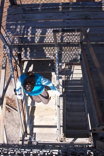 Melissa descends observation tower steps