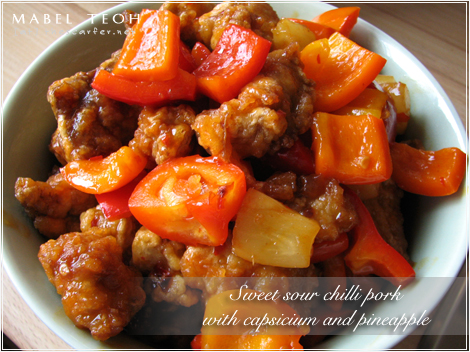 Sweet sour pork with capsicium and pineapple
