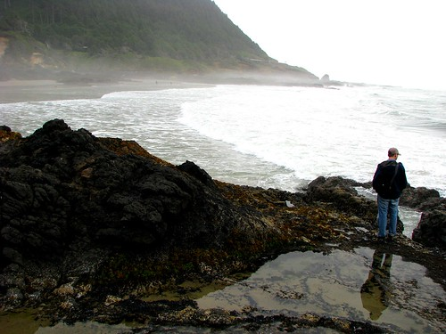 Matt contemplates the rocks at Cape Perpetua State Park, Oregon