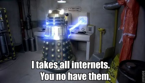 Cap from Dalek. A Dalek has its sucker to a computer screen. Captioned 'I takes all internets. You no have them.'