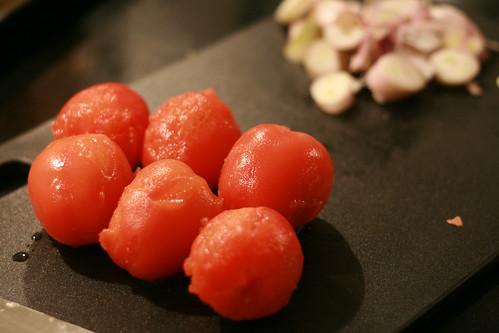 skinning vine-riped tomatoes