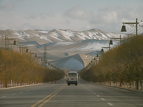 Dunhuang dunes from the road. My photo gallery on Dunhuang is here: http://www.flickr.com/photos/temoris/sets/72157615062431247/show/