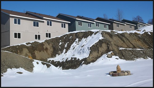 This Eagle River subdivision is the poster child for bad development.  Soils from the denuded hillside began washing down onto property below.  Before 2007 there was nothing in local codes to make erosion control mandatory.