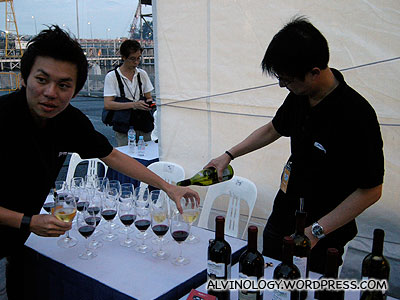 Serving wine to the VIPs and artistes