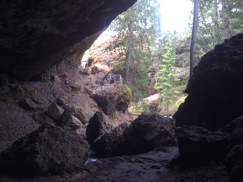 In cave, looking out by you.