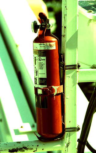 X-Pro Extinguisher. (Fuji Velvia 50 — Cross-Processed. Nikon F100. Epson V500.)