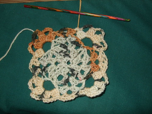 NatCroMo 2009 1st clue: square in Opal Hundertwasser sock yarn in light blue and brown shades, with good stitch definition