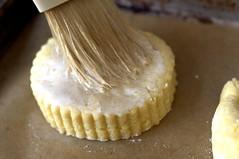 brushing shortcakes with cream