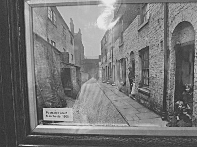 There were many photographs on the wall of the cell corridor. Although i photographed them all, some came out much better than others. This is one of the better set - a long montage of various scenes from around Manchester. This particular one shows what wouldve been a working class area - Pearsons Court, in around 1908. I dont think this street exists any more.