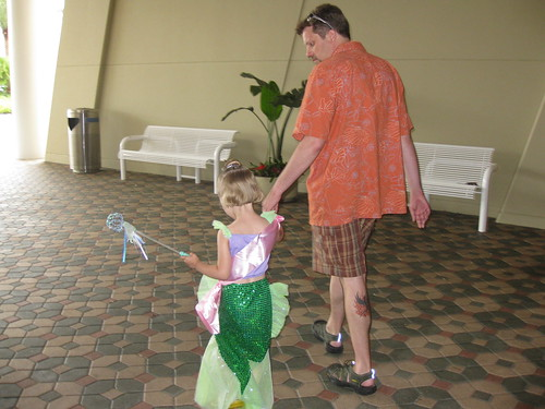 A little Ariel is escorted by her Daddy