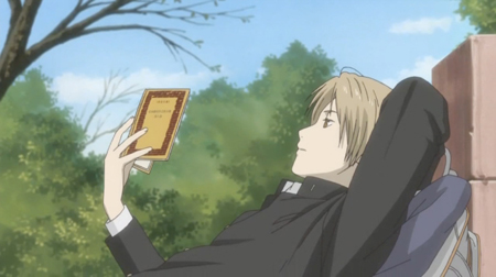 Natsume reading a book