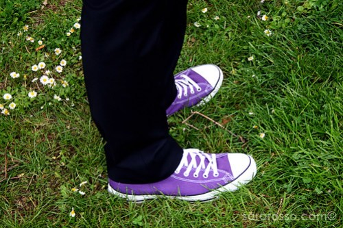 Black suit and purple Converse in grass at a Tuscan wedding