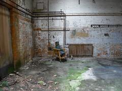 Abandoned. Child's chair. Asylum.