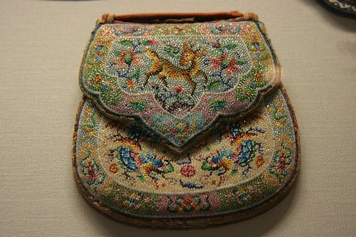 A tiny beaded pouch. The beads are smaller than your normal Mill Hill bead size. Wonder if the beader used a loupe?