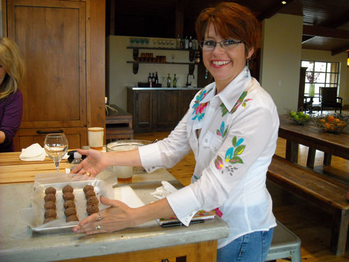 Miss Sheila demonstrating cake ball results!