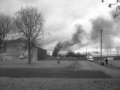 Almost what i could see when i first saw the fire, although the smoke has lessened considerably by this time. (I could hear and see lots of emergency vehicles of all kinds converging on the spot too).