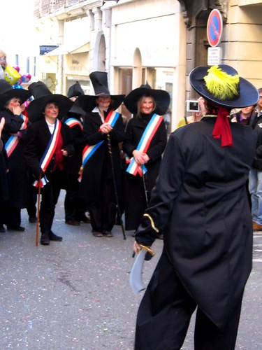 A group of revolutionaries is photographed by a pirate at the Carnaval de Romans.