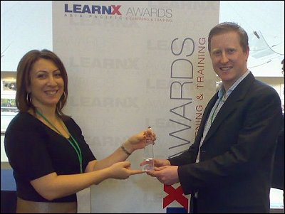 Dianne Yaako and Ryan Tracey show off their Green Training Award