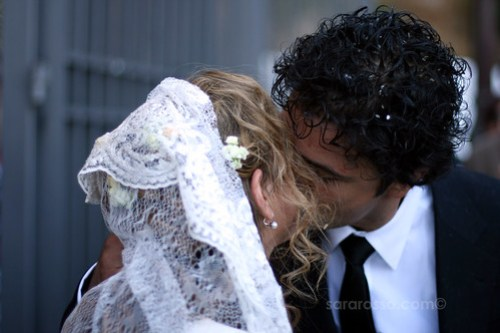 Italian Bride and groom kiss after being pelted with rice