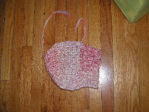 Thumbless mitten-shaped fabric